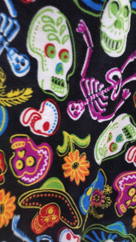 Sugar calavera by david textiles black polar fleece fabric skulls