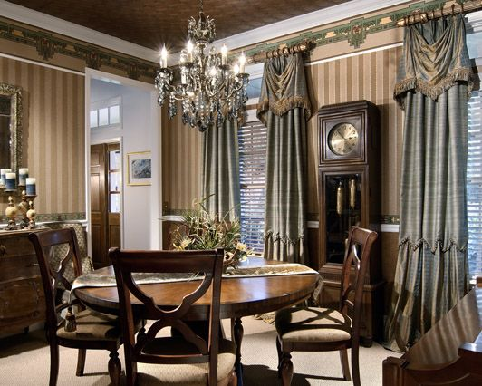 vertical stripes and floor length window treatments bring height