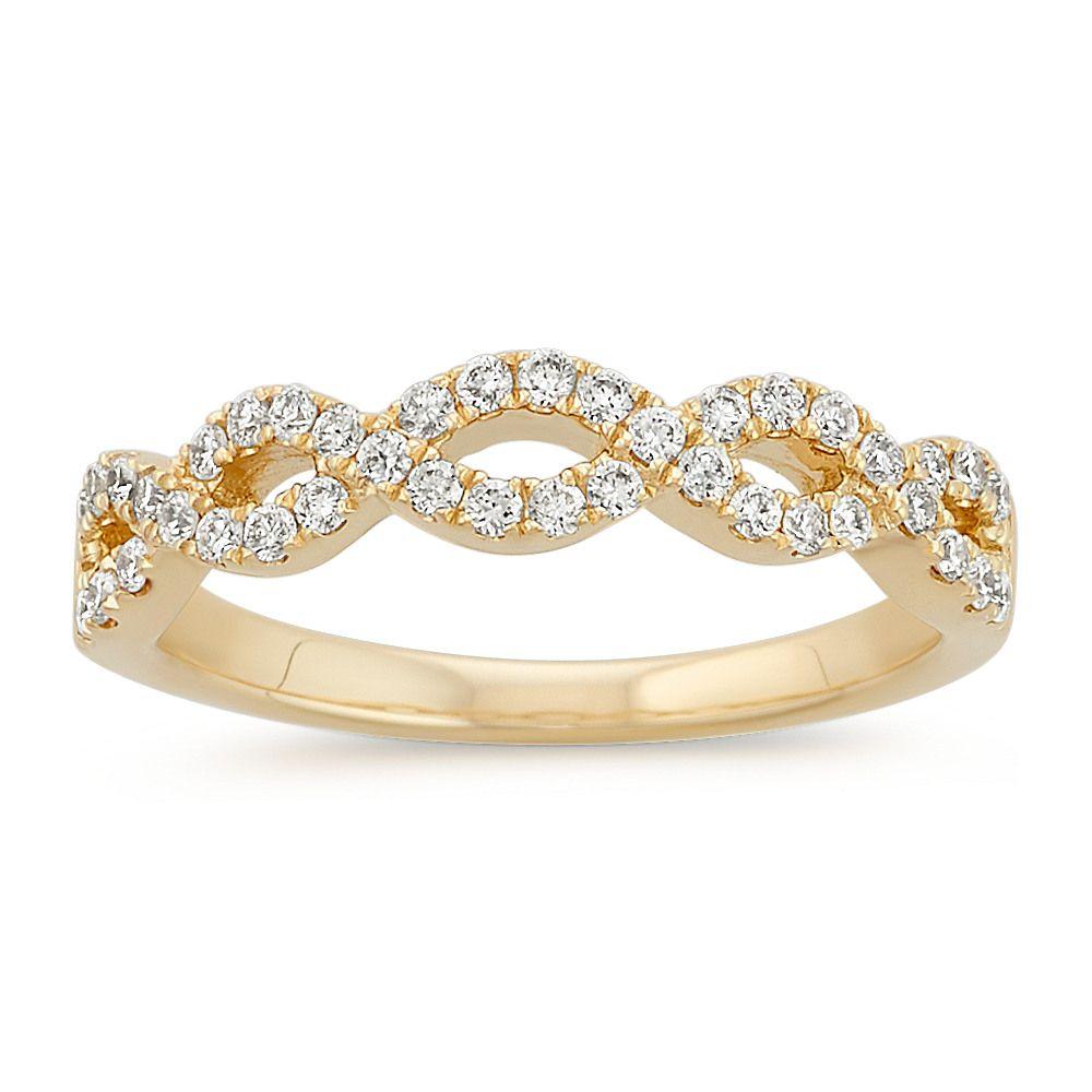 Diamond infinity swirl wedding band in yellow gold