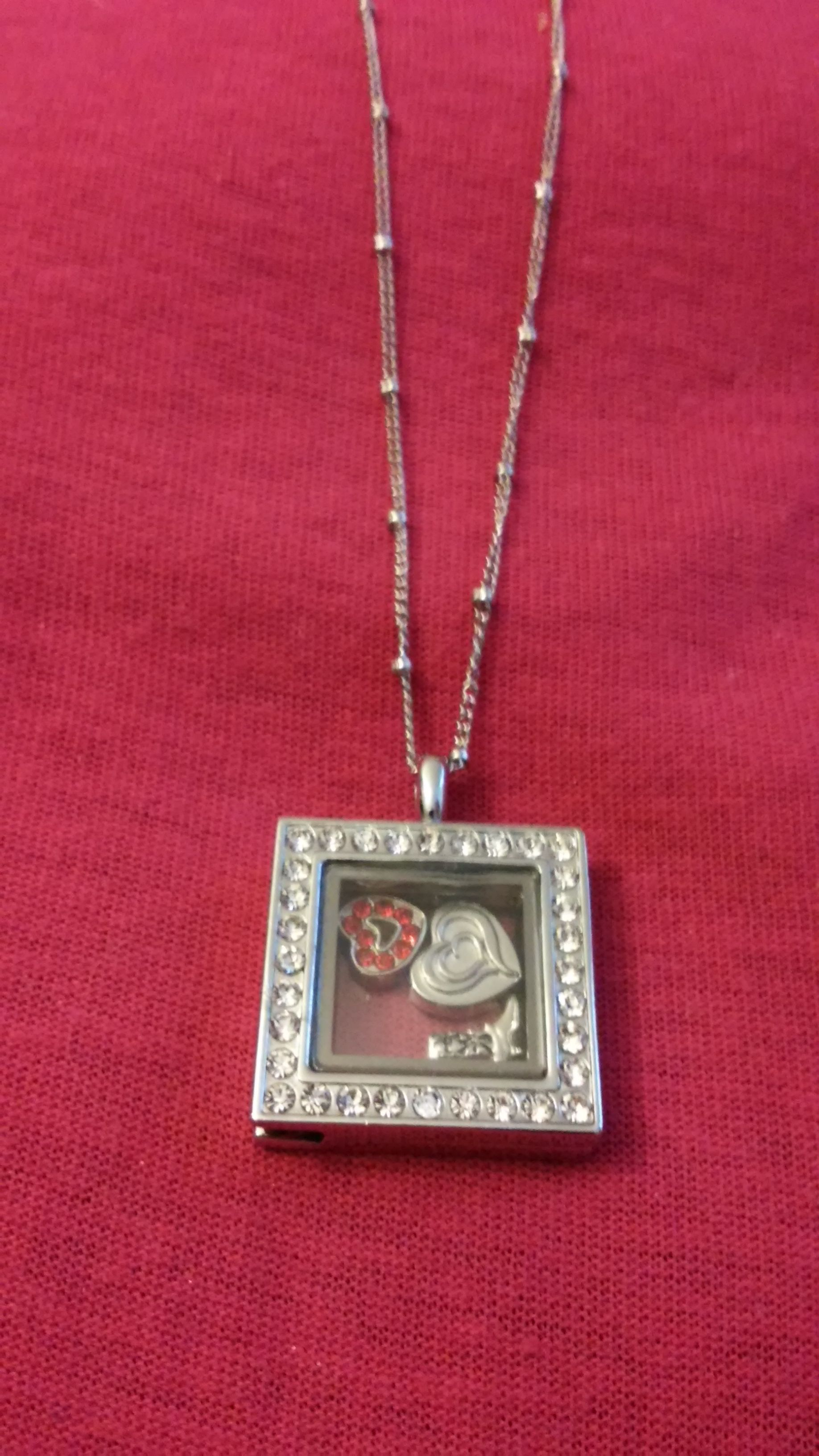 silver stone sq locket with 2 charms, free ohd charm included and 18in ball chain $20 message: milagrosourheartsdesire@gmail.com