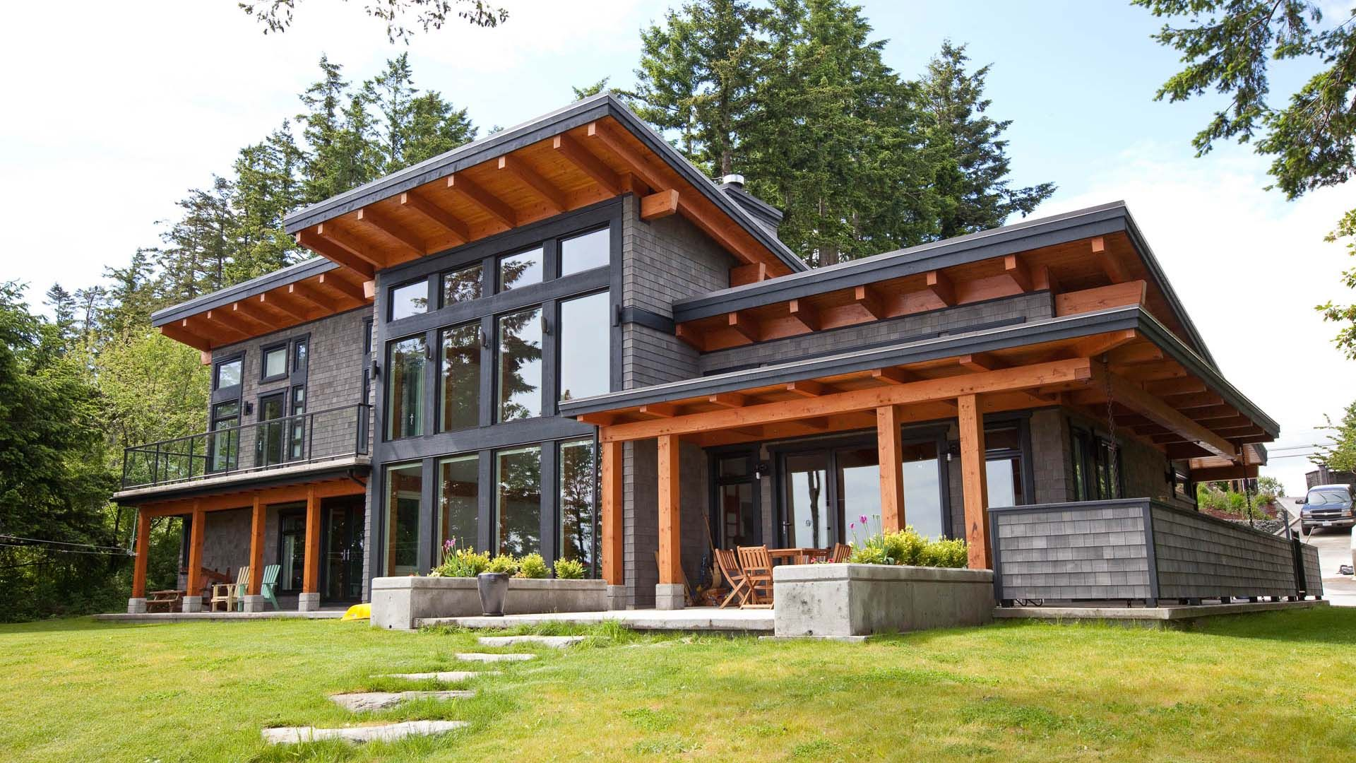 A signature west coast contemporary design this modern for Timber frame hybrid house plans