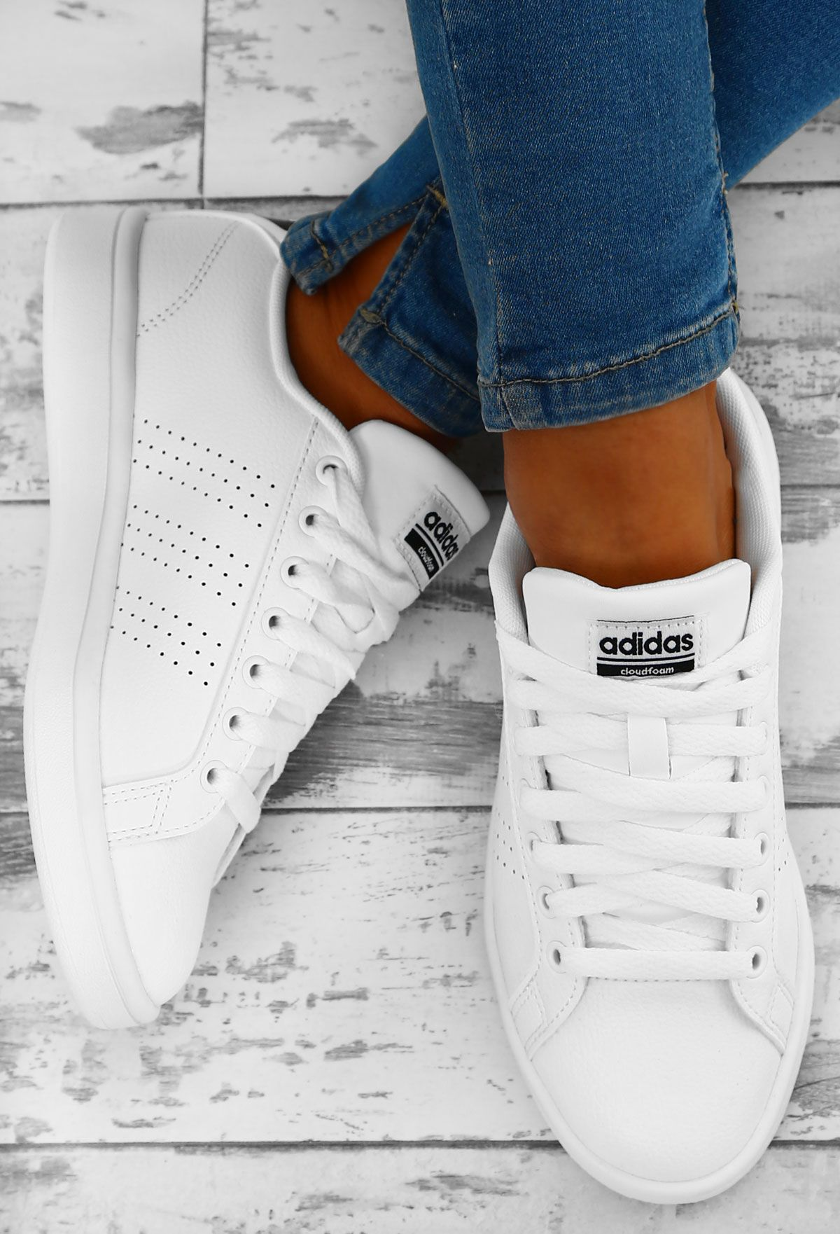 06e23076ca9 Keep your feet lookin' on fleek with these white Adidas Advantage trainers.  In a
