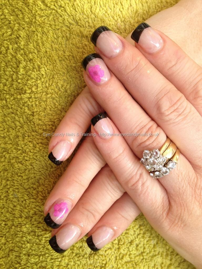 Full set of acrylic with dried flowers as nail art and black polish ...