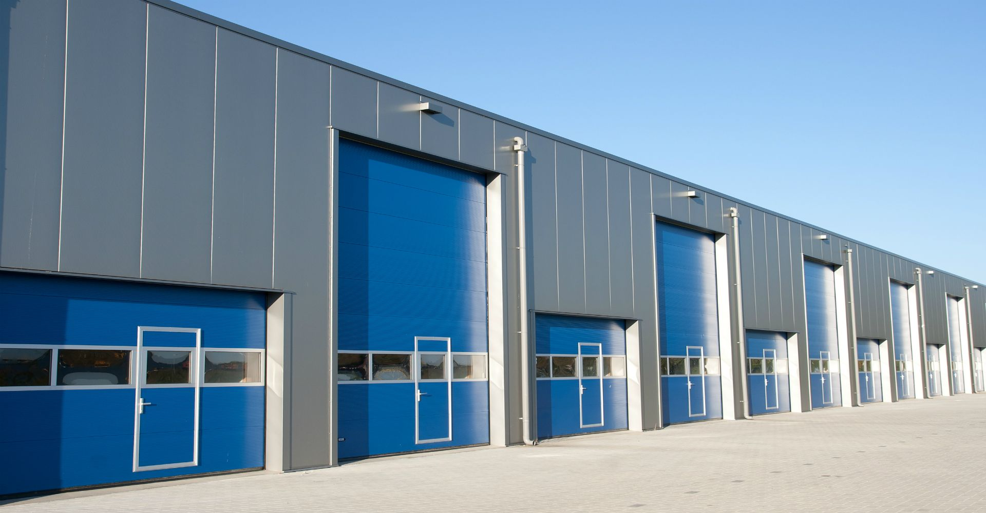 4 Important Qualities That Will Help You Better Decide On The Right Commercial Overhead Door Garage Doors Commercial Garage Doors Garage Door Repair