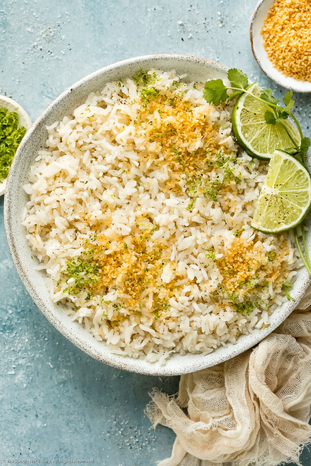 Overhead photo of easy coconut rice garnished with toasted ...