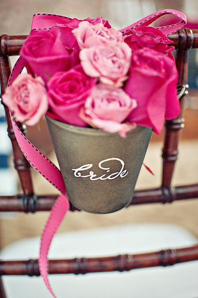 www.thedazzlingdetails.com, tin pail with florals hanging on back of bride's chair