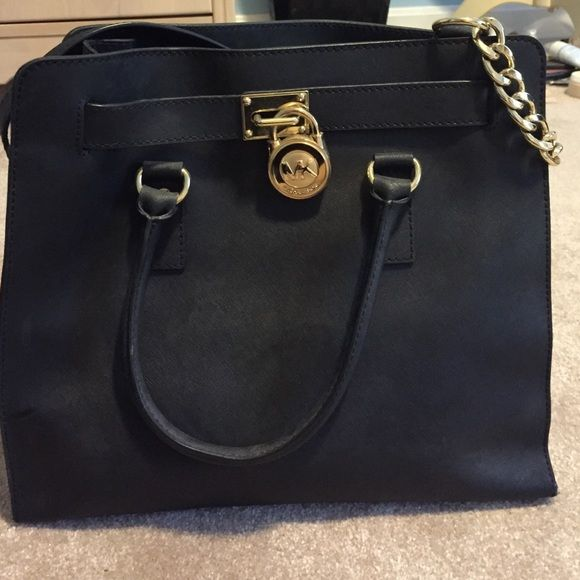 a1fbcb4e8d50c6 buckled Michael Kors Purse beautiful medium sized black handled purse,  includes a detachable gold chain handle. big gold MK buckle down the center  Michael ...