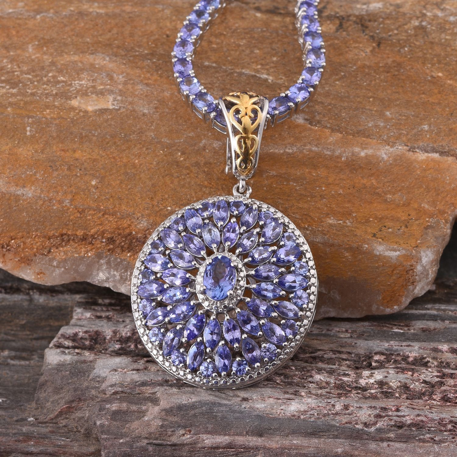 Tanzanite k yg and platinum over sterling silver pendant and