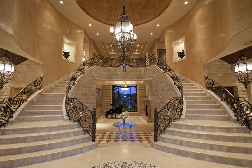Foyer Area Xl : Mediterranean staircase with cathedral ceiling symmetry