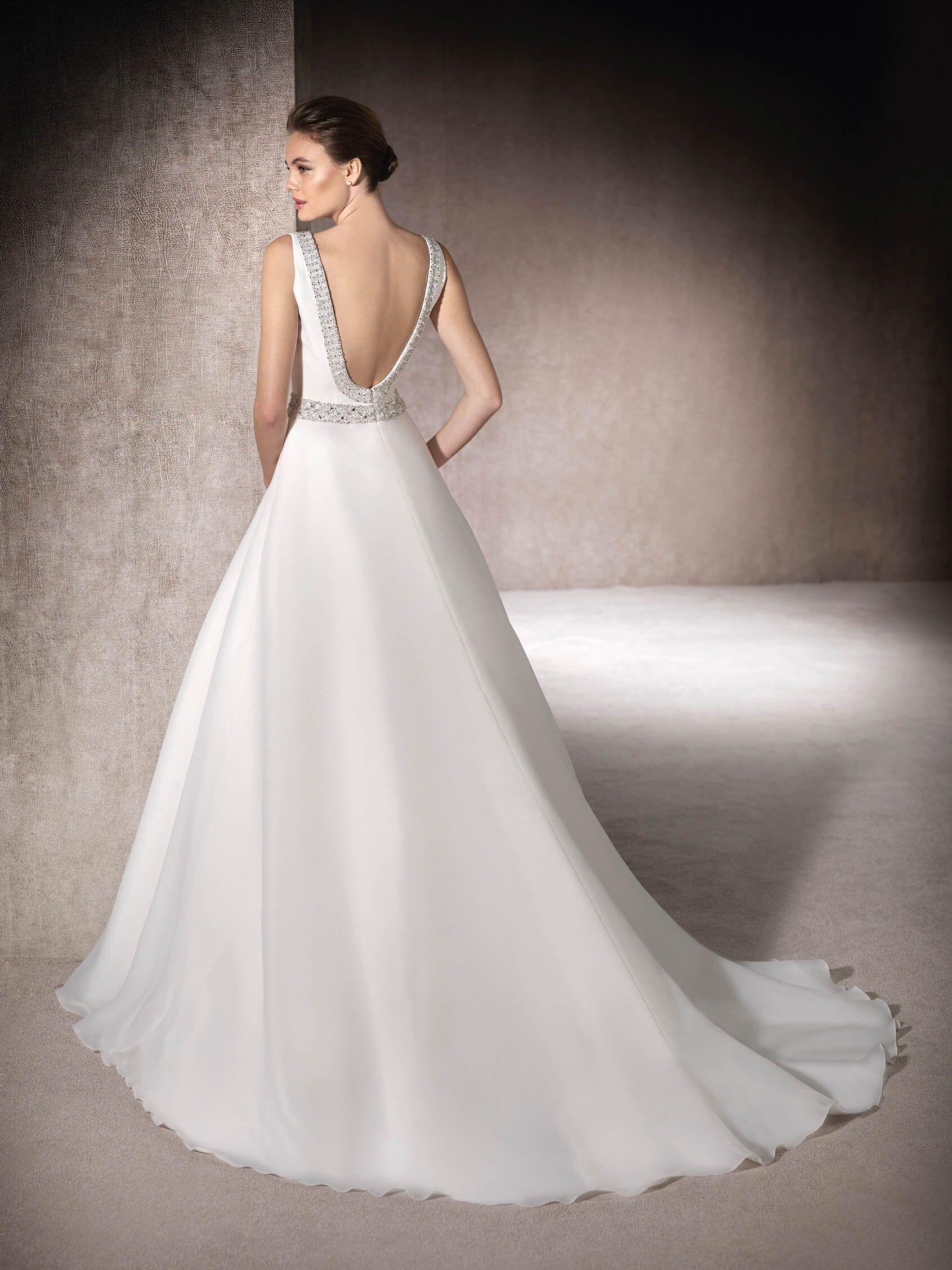 MELBA is a majestic wedding dress in garza with delicate gemstones ...
