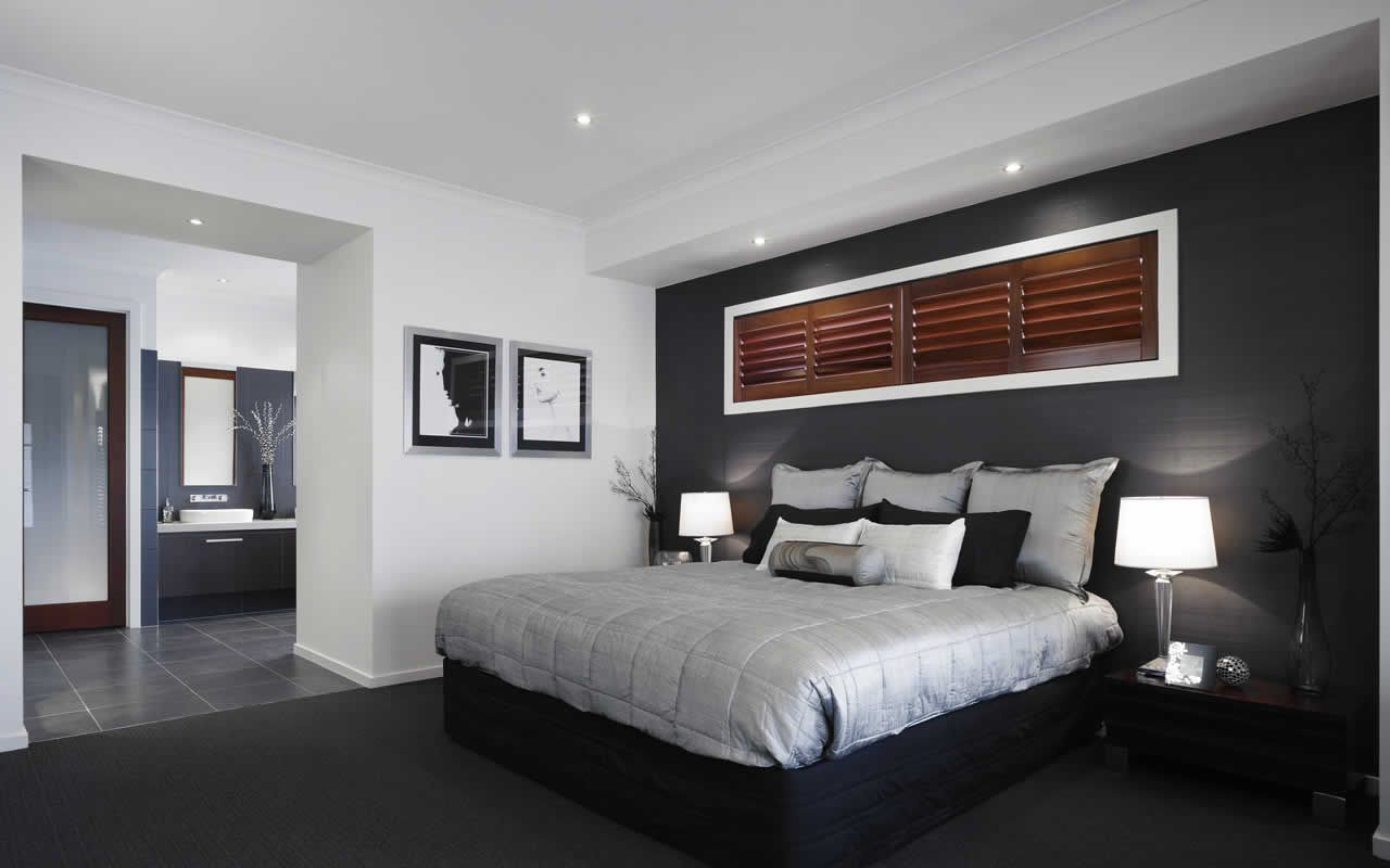 Dark grey feature wall with white trim looks great for Feature wallpaper bedroom ideas