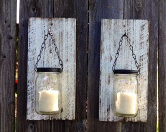 Set of two white barn wood mason jar candle holders. Barn wood painted white and distressed. Mounting hardware included. Order includes 2 barnwood sconces and jars, as seen in photo.  Each set will vary slightly due to the variations in the barn wood. Candles used for photo only, not included with purchase.  Made and shipped from Sonoma County wine country, California.  12 1/2 x 6