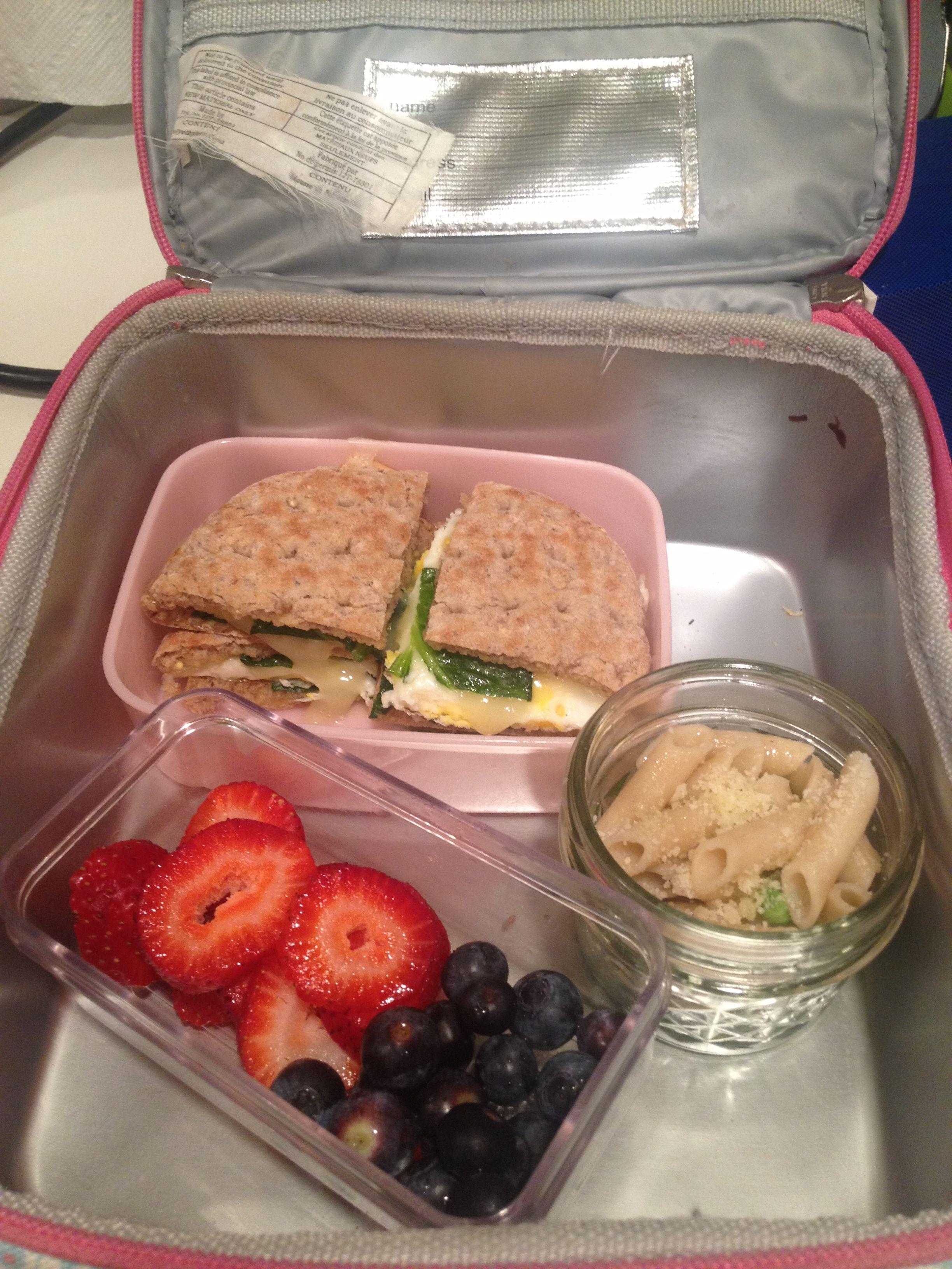 Egg sandwich, fresh berries, and pasta