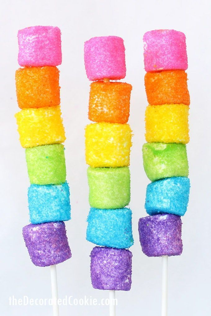 Rainbow marshmallow kabobs! Sprinkle-coated marshmallows. How to make rainbow marshmallow kabobs, sprinkle-coated marshmallows stacked on lollipop sticks
