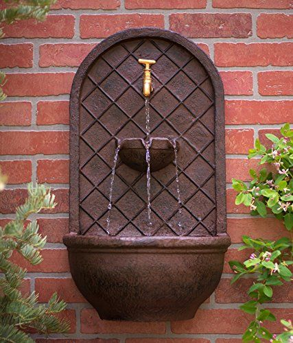 The Milano Outdoor Wall Fountain Weathered Bronze Finish Water
