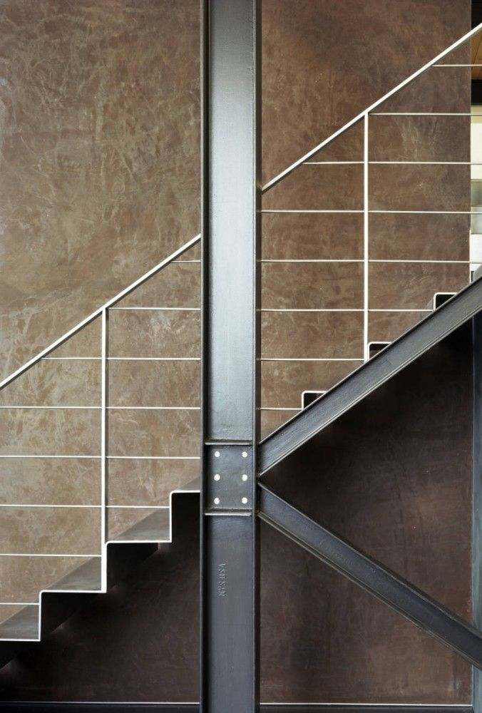 Exposed steel frames bolted with a matching staircase, creating an impression of structurally functional aesthetics... boosts architectural cred~