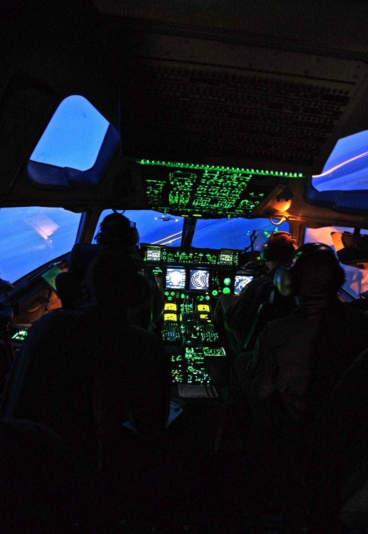 Boeing C17 Globlemaster III cockpit at night. Cockpit
