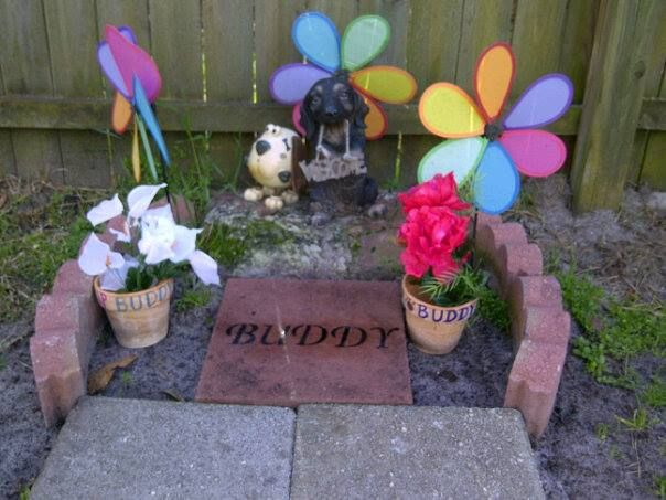 Our homemade headstone, for my dear sweet, Buddy. Just a paver, stencils, permanent markers, and clear spray.