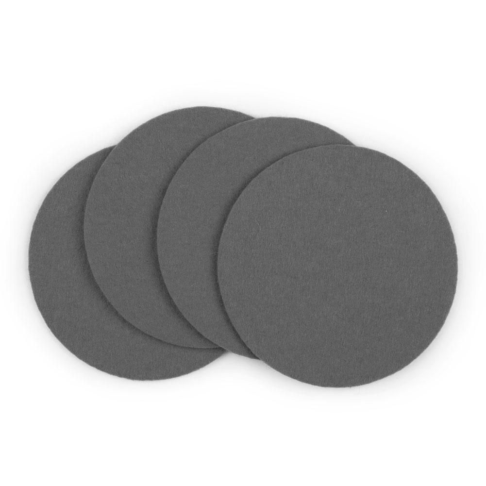 100% Merino Wool Coaster SetMade of 100% merino wool felt with vegetable-based dyes, these Designer Wool Felt Coasters will add textural interest to your living room or dining room decor. The surprisingly functional material is perfect for the eco-conscious decorator. The natural wool wicks away moisture while protecting your surfaces from condensation. Each coaster is certified free of harmful substances and is easy to spot clean with a damp cloth. SpecsContent: 100% merino wool felt. Diameter: