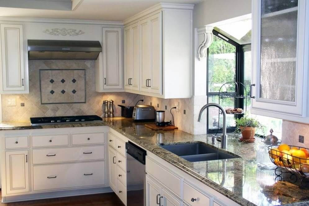 Small Bay Window Above Kitchen Sink With White Kitchen Cabinets