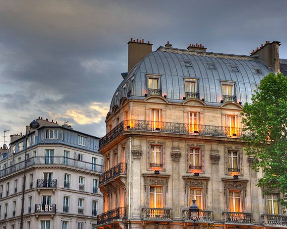 Evening Paris Gorgeous Photo Of Old Honey Colored Apartment Building In With Gray Metal Mansard Roofs Under A Stormy Sky Toward
