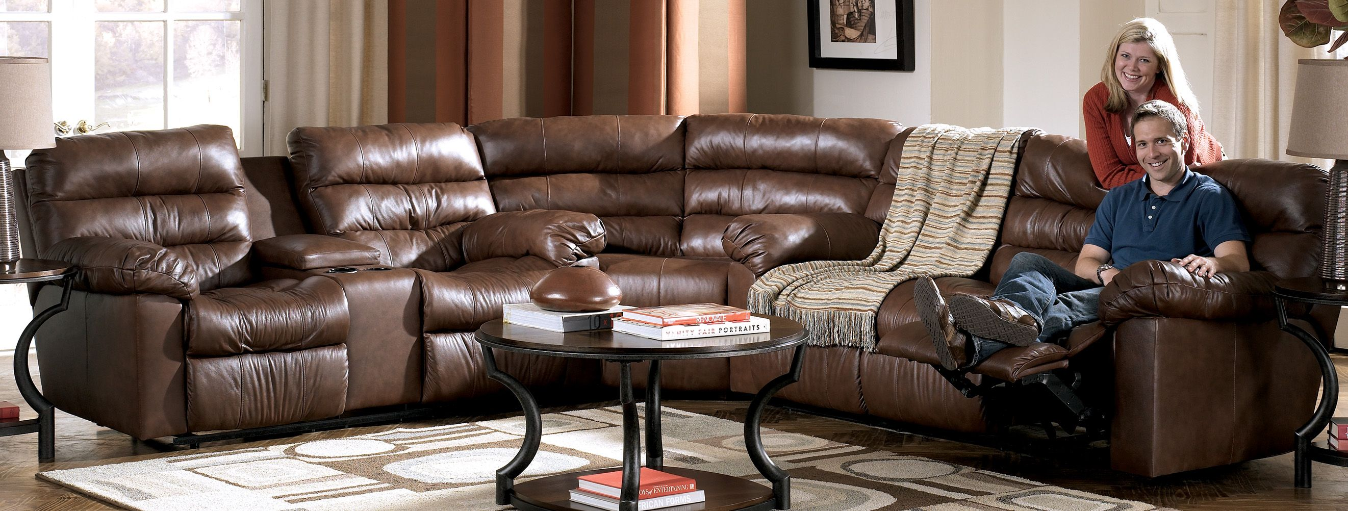 Reclining Leather Sectional Sofa with 4 Recliners and a Console
