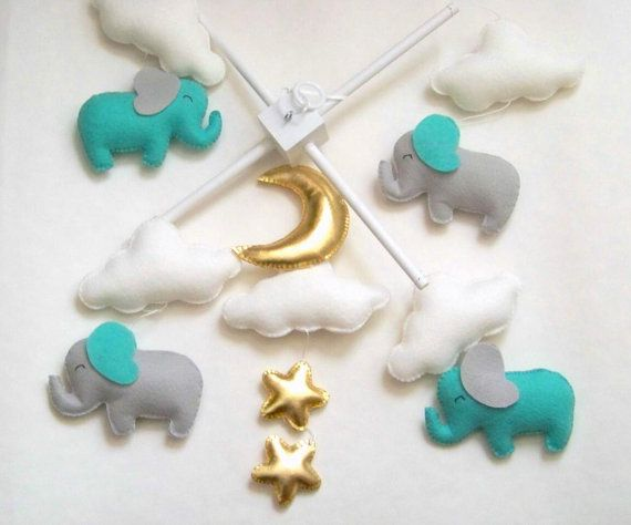 Hey, I found this really awesome Etsy listing at https://www.etsy.com/listing/248619556/mint-and-gray-elephant-baby-mobile