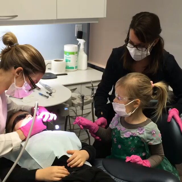 Happy family who work together. Momma dentist, Georja dental assistant and Wyatt the dental patient.
