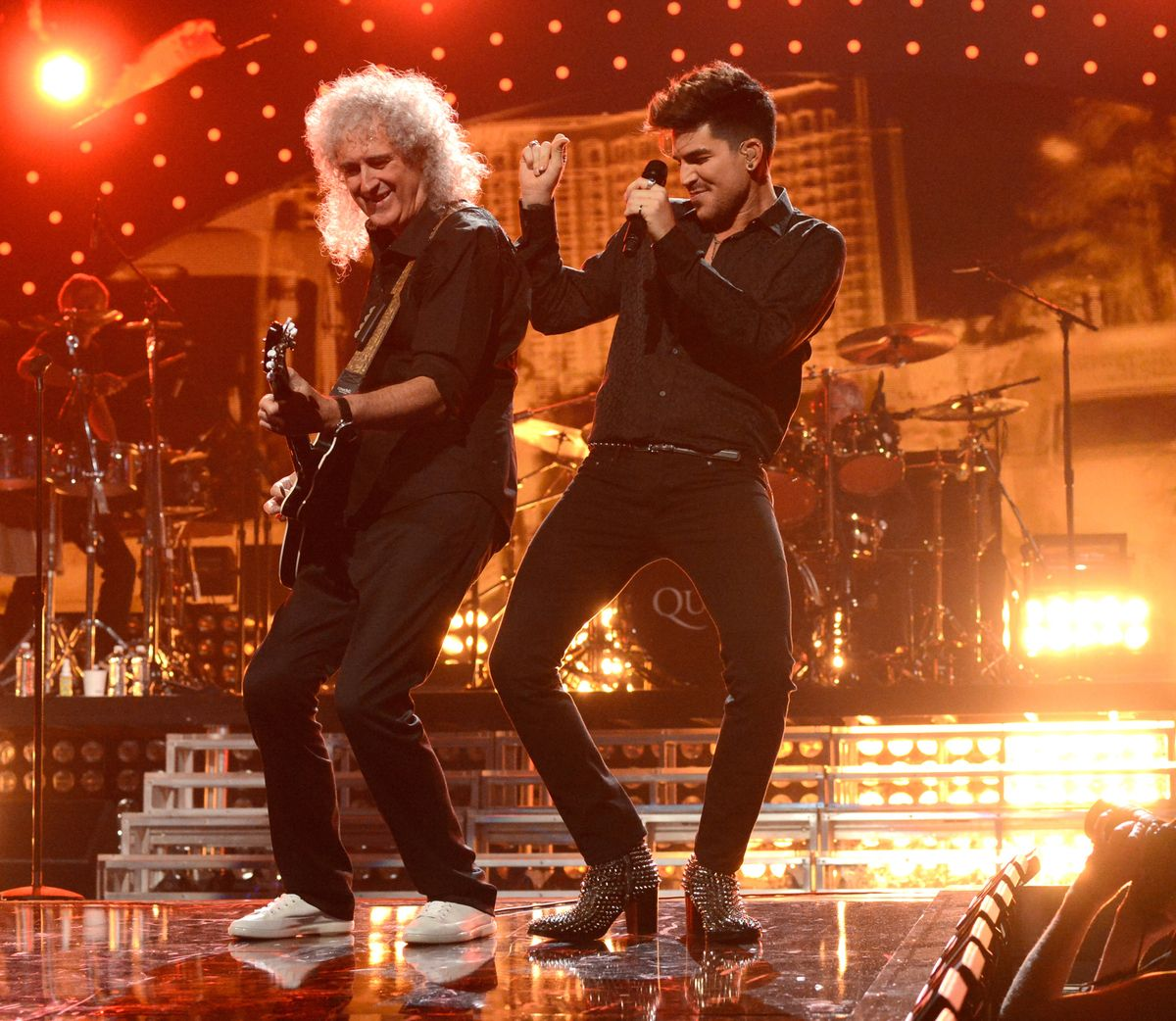 Adam Lambert and Brian May of Queen perform onstage during the ...