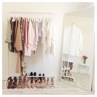 Who knew a simple rail could look this good? | 17 Minimalist Wardrobes That Will Make You Want To Throw Half Your Clothes Out