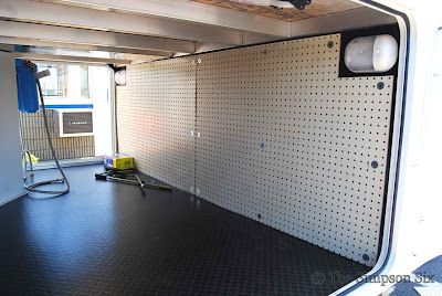 Line the walls of the camper's compartments with pegboard