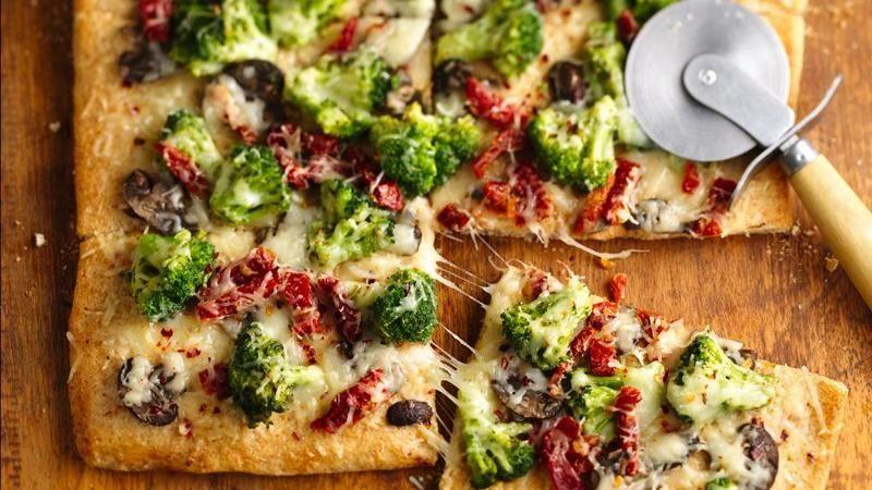 Deliciously Seasoned Tuscan Broccoli Topped On Artisan Pizza Crust Creates An Ultimately Amazing Veggie