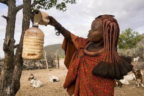 Himba Girl Collecting Milk In The Morning Eppupa Namibia