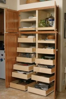 Pantry System By The Pull Out Shelf Company We Love These Kind Of Drawers That Make A Standard Cabinet So Much More User Friendly
