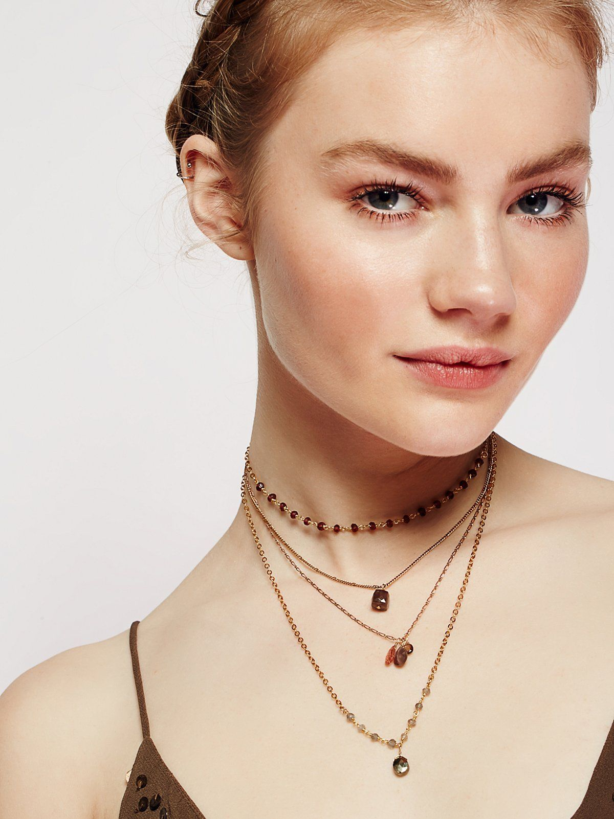 Delicate Quad Tiered Necklace | Multi-layered tiered necklace featuring beautiful xx stones. Adjustable lobster clasp closure.
