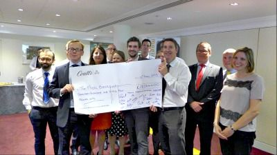 Coutts employees with fundraising cheque