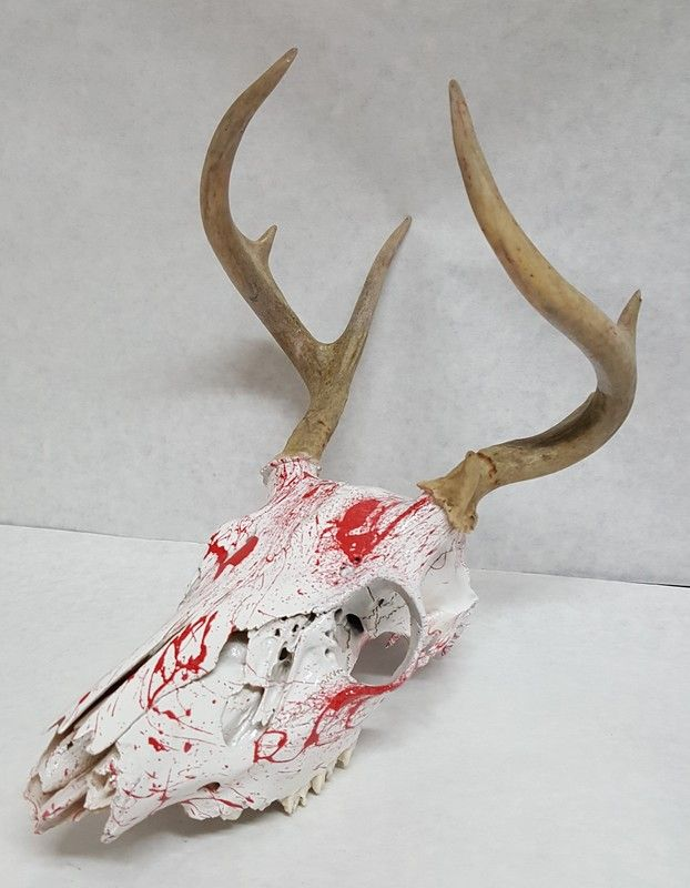 Hydro Horn hydro dipped deer skull in blood splatter from toxic hydrographics