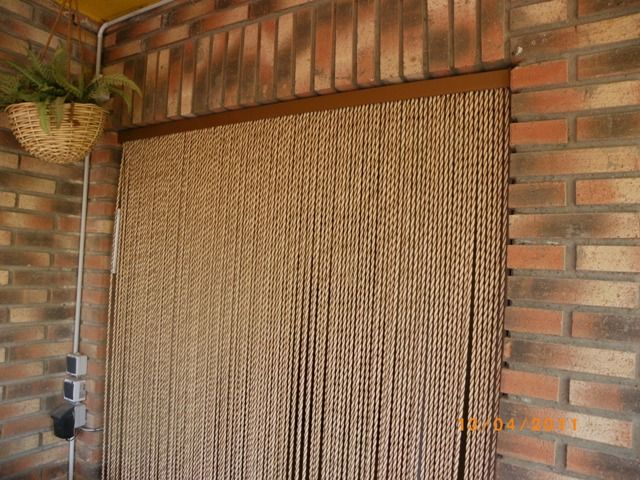 Cortinas de tiras de plastico antimoscas rural for Cortinas decorativas para puertas