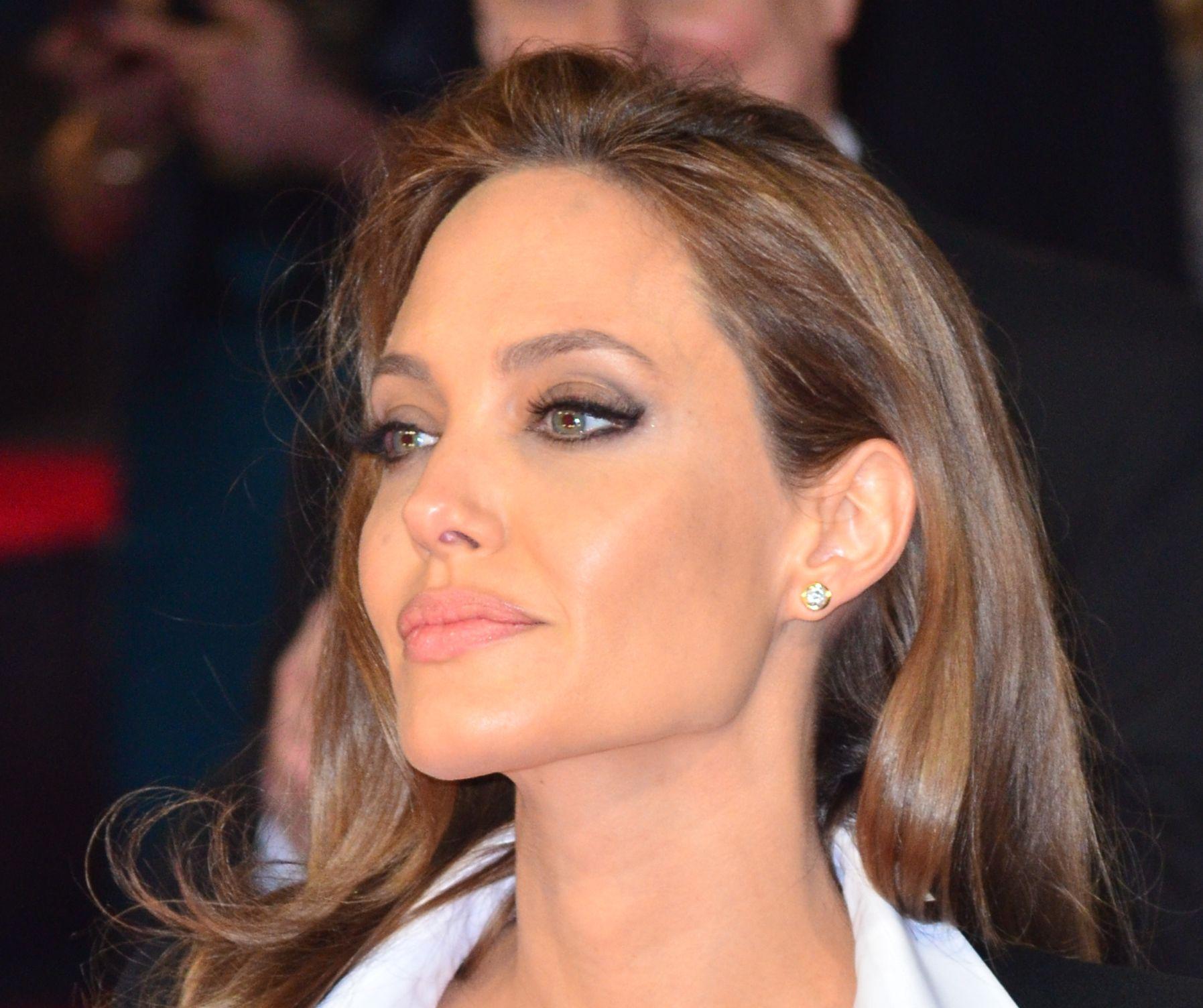 Angelina Jolie in Saint Laurent and Tiffany & Co. jewelry ...