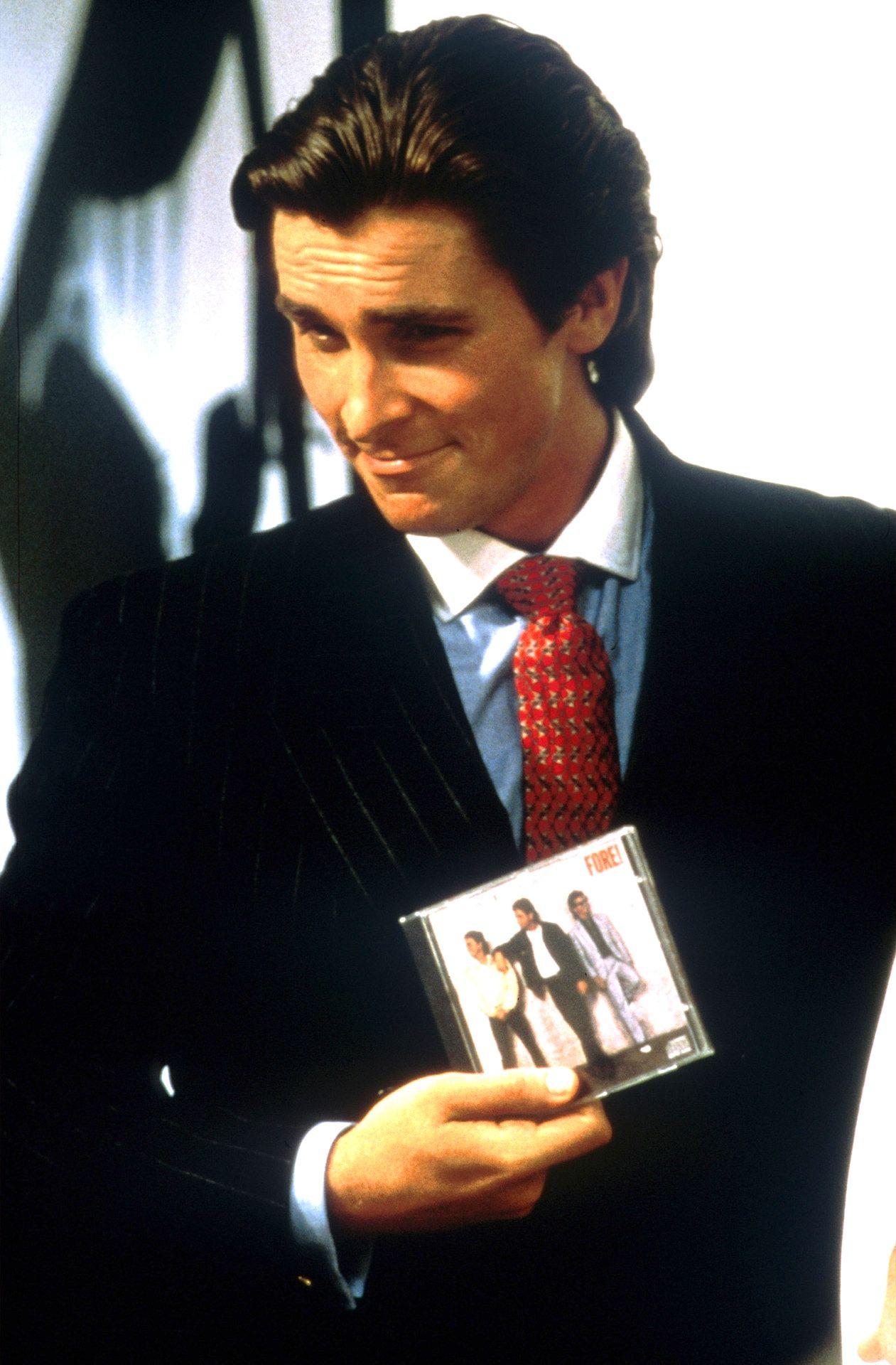 Christian bale as huey lewis fan patrick bateman in american christian bale as huey lewis fan patrick bateman in american psycho reheart Images