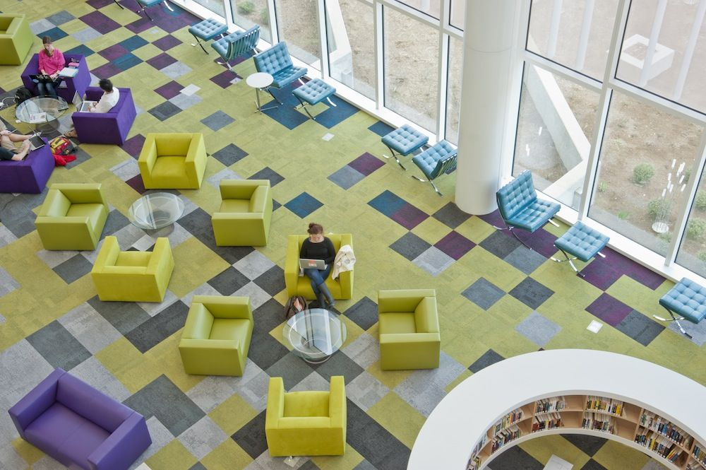 {Colorful Modular Carpet Tile laid throughout a library.}