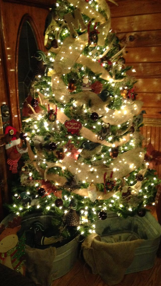 rustic christmas tree with deer antlers duck dove decoys burlap and moss