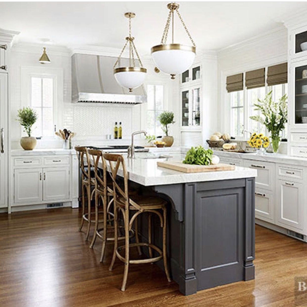 white kitchen with dark island Better Homes and