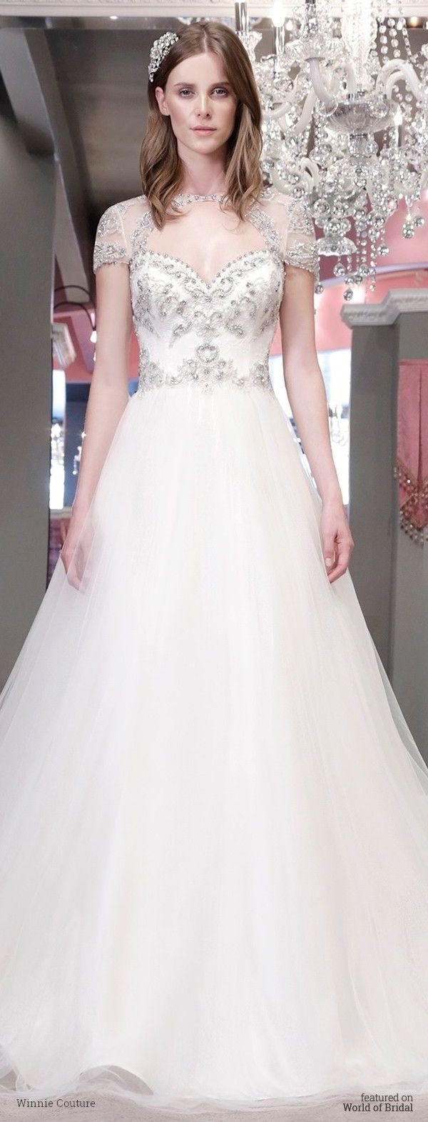 Decorative tulle fit and flare with crystal pattern lines on bodice and skirt, lace cut out under bust with crystal straps to exposed open back