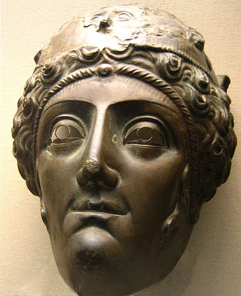 Ancient Roman bronze female mask, perhaps of an Amazon, masks like this  were usually worn by cavalry soldiers in parades. Found on a skeleton's face in a tomb at Nola, Italy, 2 century A.D.