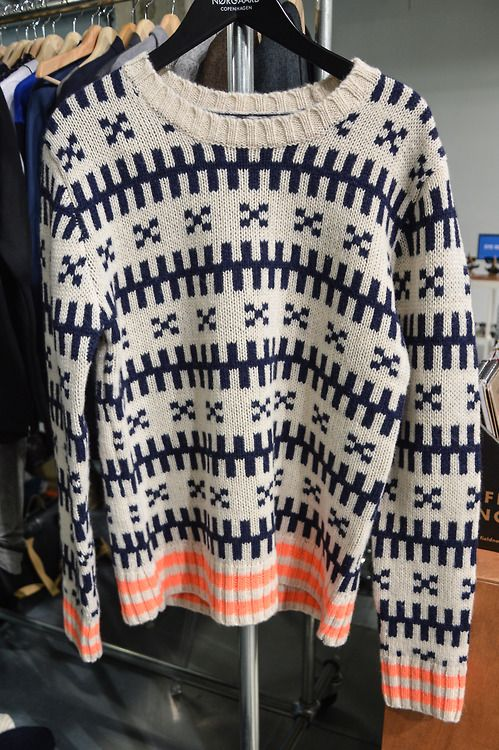 Iconic Nordic sweater with signature orange detail by Mads Nørgaard at the Capsule Paris trade show.