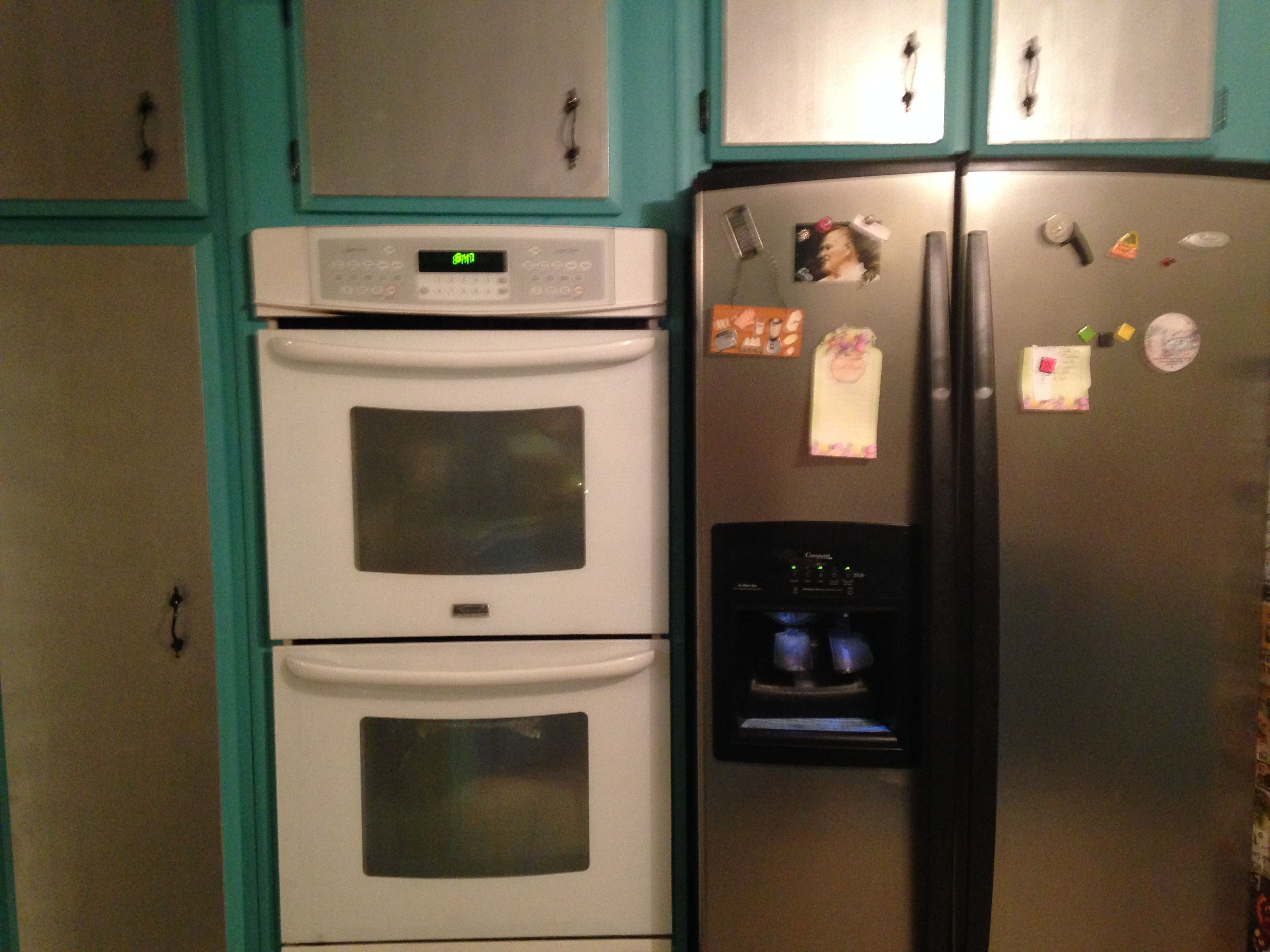 Painted Cabinet Fronts Silver to help the Appliances blend. Rustoleum Metallic Silver