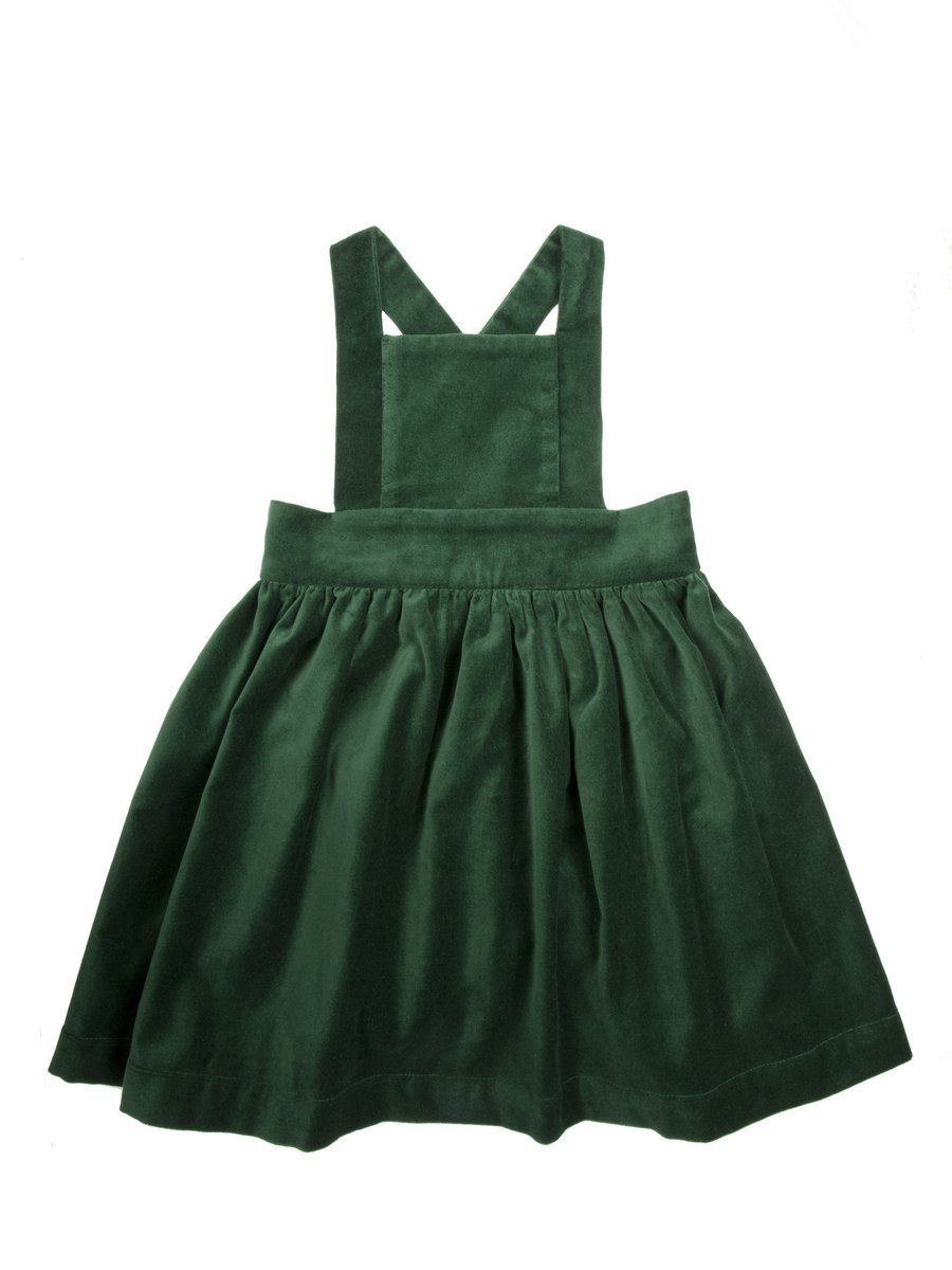 ad6634966 Our 2nd Edition Pinafore in Velvet is sure to make a statement this winter.  Criss cross strap closure with 2 wooden buttons.