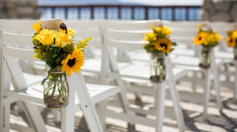Sunflower Chair white chair aisle decoration with yellow roses and sunflower in