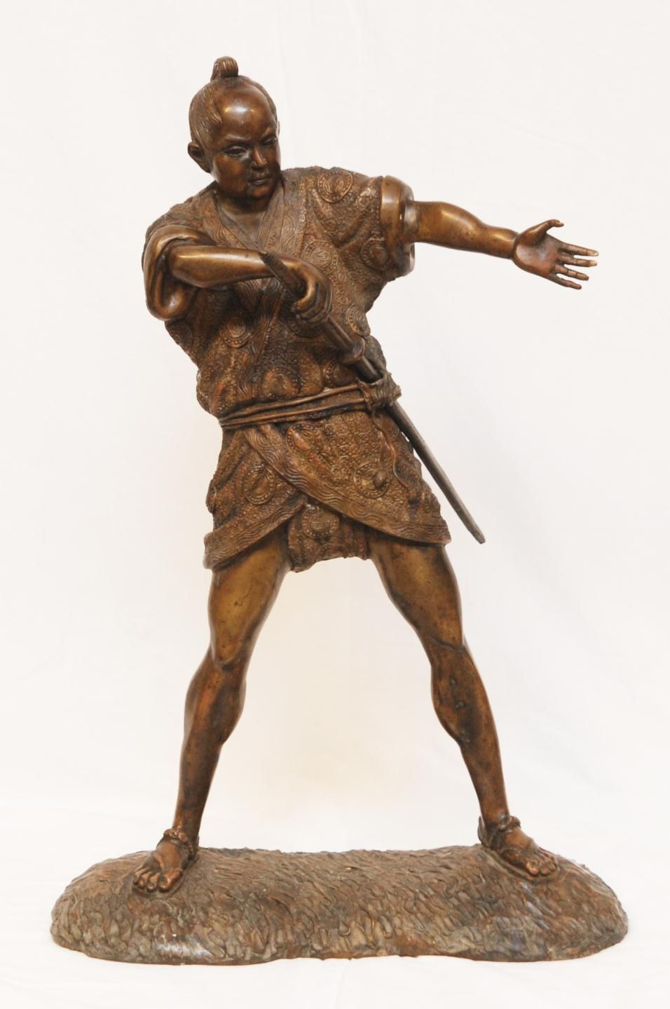 old japanese bronze of samurai drawing sword sculptures and